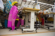 A garment worker at work on a sewing machine inside  Epyllion Group garment factory in Bangladesh.