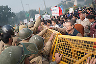 23rd Dec. 2012. A protester tries to placate riot police during a demonstration in central New Delhi. The demonstrators were reacting to the news of a gang-rape of a young medical student in the Indian capital.