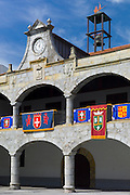 Spanish banners at medieval building in Plaza de la Constitucion 19 March 1812 in Laredo, Cantabria, Spain