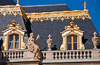 Palace of Versailles. Baroque gilt decoration on the roof and uppermost windows.