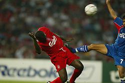 BANGKOK, THAILAND - Thailand. Thursday, July 24, 2003: Liverpool's Emile Heskey and Thailand's Chukiat Nusarung during a preseason friendly match at the Rajamangala National Stadium. (Pic by David Rawcliffe/Propaganda)