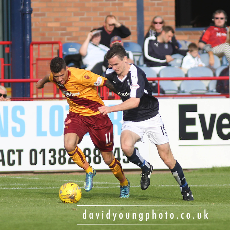 Dundee&rsquo;s Paul McGinn goes past Motherwell&rsquo;s Marvin Johnson - Dundee v Motherwell - Ladbrokes Premiership at Dens Park<br /> <br /> <br />  - &copy; David Young - www.davidyoungphoto.co.uk - email: davidyoungphoto@gmail.com