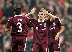Munich, Germany - Wednesday, March 7, 2007: Bayern Munich's Lucio and Lukas Podolski celebrate scoring against Real Madrid during the UEFA Champions League First Knock-out Round 2nd Leg at the Allianz Arena. (Pic by Christian Kolb/Propaganda/Hochzwei) +++UK SALES ONLY+++