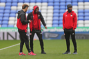 Brentford Kamo Mokotjo (12) centre, having a laugh when checking out the pitch with  Brentford Florian Jozefzoon (7)    right,  the EFL Sky Bet Championship match between Reading and Brentford at the Madejski Stadium, Reading, England on 20 January 2018. Photo by Gary Learmonth.