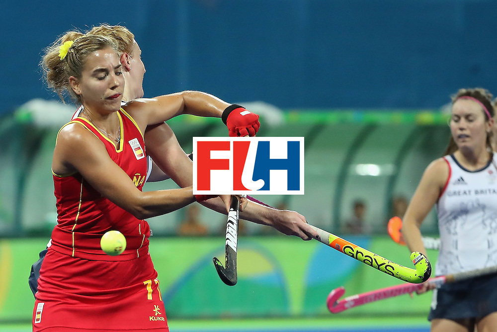 RIO DE JANEIRO, BRAZIL - AUGUST 15:  Cristina Guinea #11 of Spain attempts to control the ball during the quarter final hockey game against Great Britain on Day 10 of the Rio 2016 Olympic Games at the Olympic Hockey Centre on August 15, 2016 in Rio de Janeiro, Brazil.  (Photo by Christian Petersen/Getty Images)