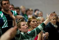 Fans of Krka celebrate during basketball match between KK Krka and BC Azovmash Mariupol (UKR) of 4th Round of Regular season of Eurocup 2011/2012 on December 6, 2011, in Arena Leon Stukelj, Novo mesto, Slovenia. Krka defeated Azovmash 74-70. (Photo by Vid Ponikvar / Sportida)