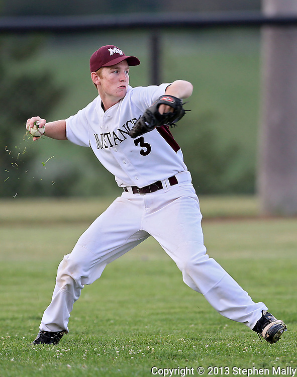 Mount Vernon's Luke Hansen (3) has a handful of grass along with the ball during the 2A District Finals game at West Branch High School in West Branch on Saturday, July 20, 2013.