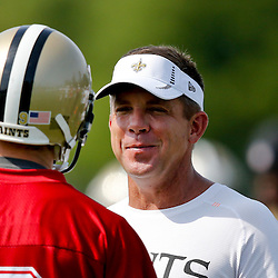 Jul 26, 2013; Metairie, LA, USA; New Orleans Saints head coach Sean Payton and quarterback Drew Brees (9) during the first day of training camp at the team facility. Mandatory Credit: Derick E. Hingle-USA TODAY Sports