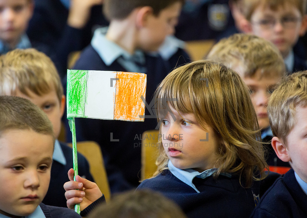 23/10/2015       <br /> Members of the Defence Forces were in Abbeyfeale today to present a handmade Tricolour and a copy of the Proclamation of the Irish Republic to students of the town's two primary schools.<br /> <br /> St Marys Boys National School and Scoil Mh&aacute;thair D&eacute; are among 3,000 schools nationally and 152 Limerick primary schools to receive the presentation as part of initiatives to mark the centenary of the 1916 Rising.&nbsp;<br /> <br /> Councillor Liam Galvin, Mayor of the City and County of Limerick joined pupils and teachers for today's presentation ceremony, which saw representatives of the Defences Forces raise the flag and read the Proclamation. <br /> <br /> Attending the ceremony at St. Marys Boys National School was Tristan Murphy. Picture: Alan Place.