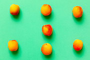 Apricots set of six  isolated over a green background viewed from above, flatlay style