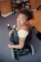 Young woman with Cerebral Palsy using wheelchair,