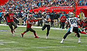 Carolina Panthers running back Christian McCaffrey (22) evades a tackle to score a touchdown on a 25-yard pass during the second quarter of an NFL International Series game against the Tampa Bay Buccaneers at Tottenham Hotspur Stadium, Sunday, Oct. 13, 2019, in London.  The Panthers defeated the Buccaneers 37-26. (Gareth Williams/Image of Sport)