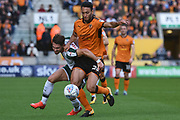 Wolverhampton Wanderers defender Roderick Miranda (25) battles for possession with Barnsley striker Tom Bradshaw (9) 0-0 during the EFL Sky Bet Championship match between Wolverhampton Wanderers and Barnsley at Molineux, Wolverhampton, England on 23 September 2017. Photo by Alan Franklin.