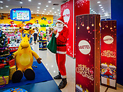 01 DECEMBER 2018 - BANGKOK, THAILAND: A Thai man in Santa Claus checks his smart phone at the Toys R Us store in Central World in Bangkok. Toys R Us closed all of their brick and mortar stores in the United States in 2018 but kept many of their overseas stores open.      PHOTO BY JACK KURTZ