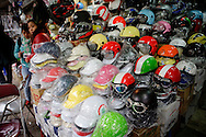 Helmet shop carries inexpensive plastic helmets for motorcyclists in Hanoi, Vietnam on Jan 10, 2013..(Photo by Kuni Takahashi)