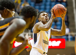 Nov 13, 2015; Morgantown, WV, USA; West Virginia Mountaineers guard Daxter Miles Jr. shoots a foul shot against the Northern Kentucky Norse during the first half at WVU Coliseum. Mandatory Credit: Ben Queen-USA TODAY Sports