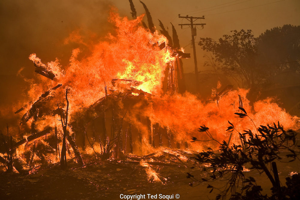 A house burns in the Twin Lakes community  of Chatsworth, CA burns to the ground..Wild fires near Porter Ranch and Simi Valley. Over 5000 acres burned with several houses burning. 60 mph Santa Ana wind event stoked the brush fires and are expected to blow all week long.