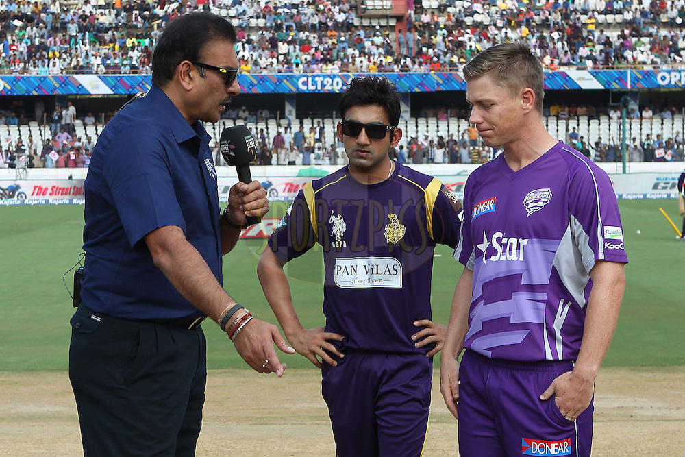 Xavier Docherty(Captain) of the Hobart Hurricanes and Gautam GAMBHIR (Captain) of the Kolkata Knight Riders  after the toss during the first semi final match of the Oppo Champions League Twenty20 between the Kolkata Knight Riders and the Hobart Hurricanes held at the Rajiv Gandhi Cricket Stadium, Hyderabad, India on the 2nd October 2014<br />