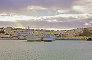 AFRICA; MOROCCO; TANGIER:  Ferries from Algeciras, Spain, at the dock in Tangier, Morocco, with the skyline of the city.