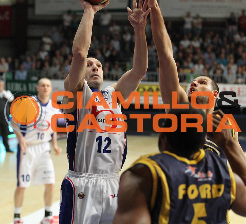 DESCRIZIONE : Cantu Lega A 2010-11 Bennet Cantu Fabi Shoes Montegranaro<br /> GIOCATORE : Nicolas Mazzarino<br /> SQUADRA : Bennet  Cantu<br /> EVENTO : Campionato Lega A 2010-2011<br /> GARA : Bennet Cantu Fabi Shoes Montegranaro<br /> DATA : 02/04/2011<br /> CATEGORIA : Tiro<br /> SPORT : Pallacanestro<br /> AUTORE : Agenzia Ciamillo-Castoria/G.Cottini<br /> Galleria : Lega Basket A 2010-2011<br /> Fotonotizia : Cantu Lega A 2010-11 Bennet Cantu Fabi Shoes Montegranaro<br /> Predefinita :