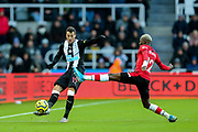 Moussa Djenepo (#12) of Southampton attempts to block the clearance from Javi Manquillo (#19) of Newcastle United during the Premier League match between Newcastle United and Southampton at St. James's Park, Newcastle, England on 8 December 2019.
