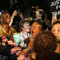 Citizens react to the not guilty verdict in the George Zimmerman murder trial at the Seminole County Courthouse on Saturday, July 13, 2013, in Sanford, Florida.  Zimmerman had been charged for the 2012 shooting death of Trayvon Martin and was found not guilty by a jury of six women. The protests on the grounds ended peacefully after the verdict was read. (AP Photo/Alex Menendez)