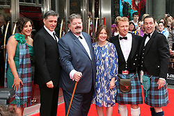 © Licensed to London News Pictures. 30/06/2012. London, UK. Robbie Coltrane (holiding cane) Brave film premier in Edinburgh. Photo credit : Michael Andrew/LNP