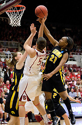 March 22, 2010; Stanford, CA, USA;  Iowa Hawkeyes guard Kachine Alexander (21) blocks a shot from Stanford Cardinal forward Michelle Harrison (5) during the second half in the second round of the 2010 NCAA womens basketball tournament at Maples Pavilion. Stanford defeated Iowa 96-67.