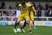 AFC Wimbledon midfielder Chris Whelpdale (11) and Rochdale FC midfielder Nathaniel Mendez-Laing (11) tussles during the EFL Sky Bet League 1 match between Rochdale and AFC Wimbledon at Spotland, Rochdale, England on 27 August 2016. Photo by Stuart Butcher.