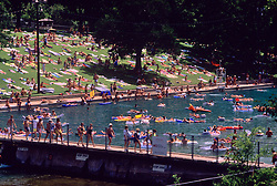 Stock photo of people enjoying a hot summer day at Barton Springs, Austin