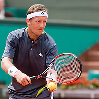 04 June 2007: Jonas Bjorkman of Sweden serves to Carlos Moya of Spain during the French Tennis Open fourth round match won 7-6(5), 6-2, 7-5 by Carlos Moya over Jonas Bjorkman on day 9 at Roland Garros, in Paris, France.