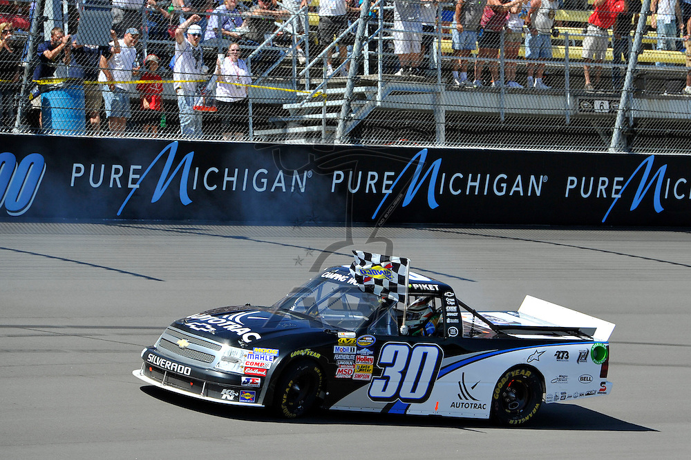 Brooklyn, MI  - Aug 18, 2012: The Nascar Sprint Cup Series practices for the Pure Michigan 400 at Michigan International Speedway in Brooklyn, MI.