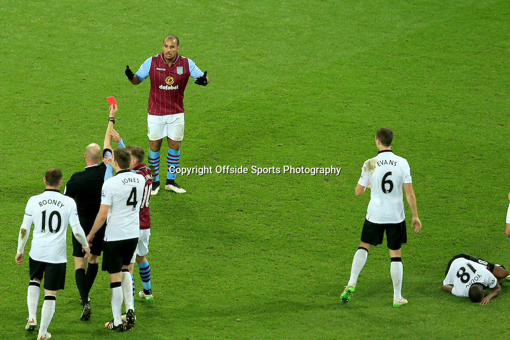20 December 2014 - Barclays Premier League - Aston Villa v Manchester United - Gabriel Agbonlahor of Aston Villa is sent off by Referee, Lee Mason for a challenge on Ashley Young of Manchester United (R) - Photo: Marc Atkins / Offside.