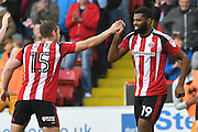 Sheffield United Player Paul Coutts (15) celebrates with Sheffield United player Ethan Ebanks- Landell (19) after he scored the first two goals to go 1-0 up during the EFL Sky Bet League 1 match between Sheffield Utd and Port Vale at Bramall Lane, Sheffield, England on 15 October 2016. Photo by Ian Lyall.