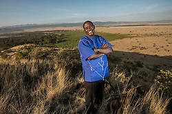"""Born into the Samburu tribe of northern Kenya, Tom Lalampaa could have ended up following the traditional pastoral lifestyle of his people – had his brother made a different choice. When Tom was a child, his father called his sons to him and said, """"I'd like one of you to go to school and the other to remain here and help take care of the cattle."""" The decision fell to Tom's brother, as the eldest. He opted for the cattle, and Tom was sent to school. Ultimately – with the support of the entire community – he went on to complete a BA in social work and an MBA in strategic management at the University of Nairobi. His brother's choice wound up changing not only Tom's life but also that of the Samburu community and the land they call home. As community development manager for the Northern Rangelands Trust (NRT), Tom is now a key player in efforts to protect Kenyan wildlife and improve the lives of his people and others who inhabit this beautiful but often unforgiving place.The Lewa Wildlife Conservancy serves as a refuge for e(Photo by Ami Vitale)"""