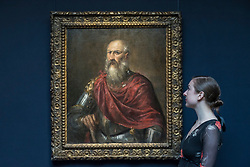 "© Licensed to London News Pictures. 01/12/2017. London, UK.  A staff member views ""Portrait of a Venetian Admiral, possible Francesco Duodo"", 1620, by Titian, (Est. 1.0-1.5m).  Preview of ""Masters of Light"", Sotheby's Old Masters Evening Sale which will take place on 6 December at Sotheby's, New Bond Street. Photo credit: Stephen Chung/LNP"