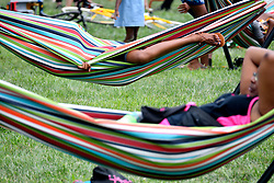 People rest in hammocks as residents, community members and locals enjoy a pop-up beach in North Philadelphia when thousands of pedestrians, cyclist, skaters, joggers participate in the third annual Philly Free Streets event at a 4mi (6.4km) car-free section of North Broad Street, in Philadelphia, PA, on August 11, 2018.