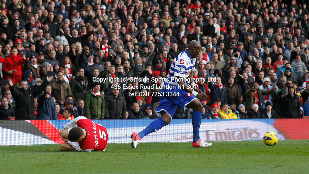 27 October 2012 Premeir League football. Arsenal v Queens Park Rangers.<br /> Arsenal captain Thomas Vermaelen holds his knee after a challenge from Stephane Mbia which resulted in a red card.<br /> Photo: Mark Leech.