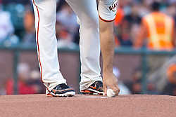 SAN FRANCISCO, CA - MAY 06: Madison Bumgarner #40 of the San Francisco Giants picks up a baseball from the pitchers mound during the first inning against the Philadelphia Phillies at AT&T Park on May 6, 2013 in San Francisco, California. The Philadelphia Phillies defeated the San Francisco Giants 6-2. (Photo by Jason O. Watson/Getty Images) *** Local Caption *** Madison Bumgarner