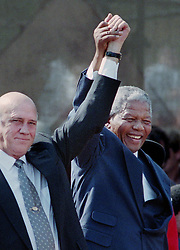April 4, 2004 - Cape Town, ZAF - South African president Nelson Mandela, right, holds hands with former South African president F.W. de Klerk in Cape Town, South Africa, in a 1994 file image. Mandela died on Thursday, Dec. 5, 2013. (Credit Image: © Jerry Holt/TNS/ZUMAPRESS.com)