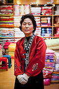 Portrait of a Korean woman in a textile shop located at the traditional market in Gongju, South Korea.