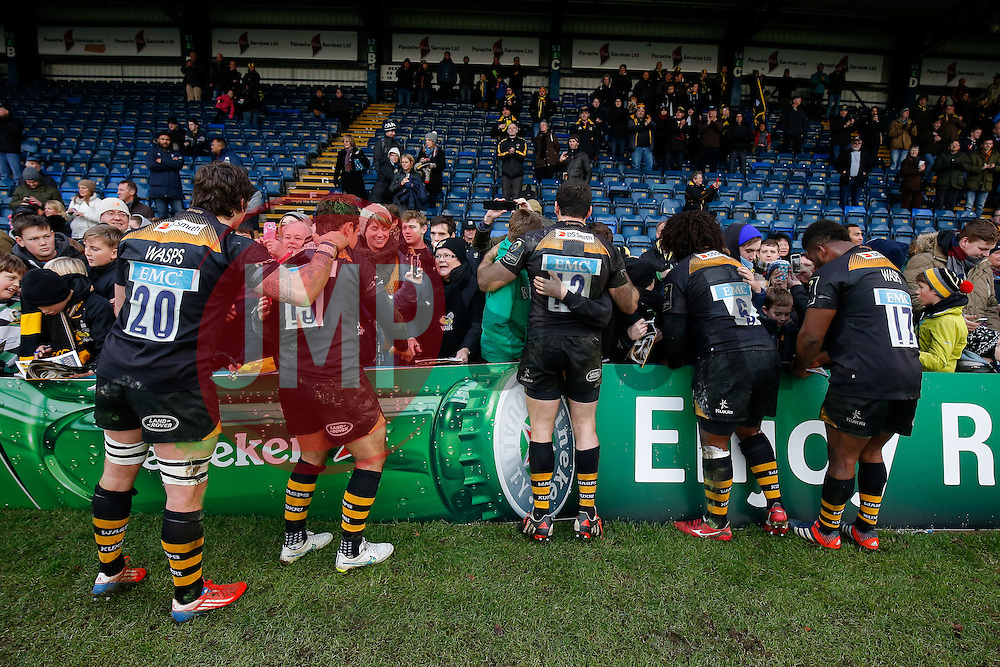 Wasps players pose for photos as they show their support and thanks to their fans after the last game at Adams Park. Wasps will play their next home game at their new home in Coventry, the Ricoh Arena - Photo mandatory by-line: Rogan Thomson/JMP - 07966 386802 - 14/12/2014 - SPORT - RUGBY UNION - High Wycombe, England - Adams Park Stadium - Wasps v Castres Olympique - European Rugby Champions Cup Pool 2.