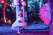 A topless woman roaming the decorated woods - The 2016 Latitude Festival, Henham Park, Suffolk.