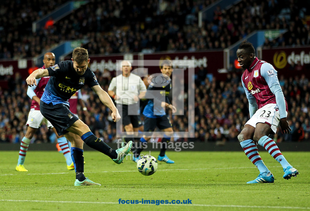James Milner (left) of Manchester City tries to cross the ball into the box past Aly Cissokho (right) of Aston Villa during the Barclays Premier League match at Villa Park, Birmingham<br /> Picture by Tom Smith/Focus Images Ltd 07545141164<br /> 04/10/2014