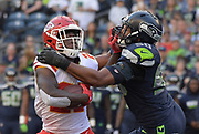 Aug 25, 2017; Seattle, WA, USA; Seattle Seahawks outside linebacker K.J. Wright (50) tackles Kansas City Chiefs cornerback Kenneth Acker (27) during a NFL football game at CenturyLink Field. The Seahawks defeated the Chiefs 26-13.