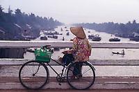 Woman on a bridge in the Mekong Delta, Vietnam