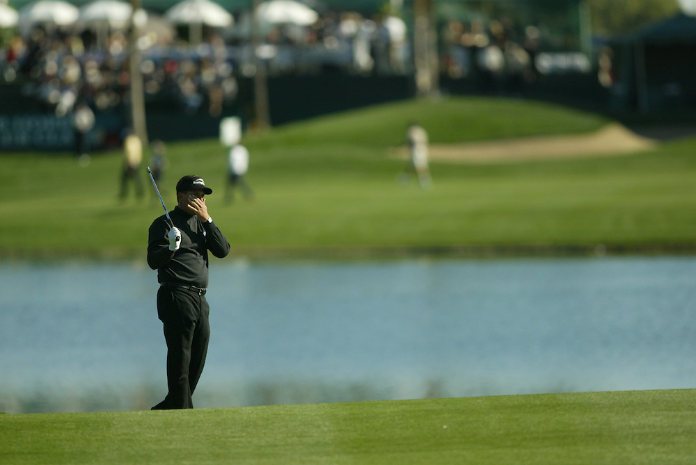 Phil Mickelson..2004 Bob Hope Chrysler Classic.Fifth Round.Palmer Course at PGA West.Sunday, January 25 2004..Photograph by Darren Carroll