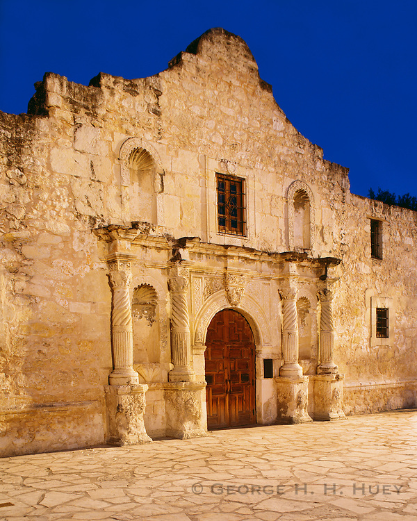 0506-1096 ~ Copyright: George H.H. Huey ~ Facade of the Alamo, at night. [AKA Mission San Antonio de Valero].  San Antonio, Texas.