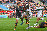 London Irish back row Albert Tuisue (8) breaks the tackle of Wasps fullback Juan De Jongh (23) to score a try during the Gallagher Premiership Rugby match between Wasps and London Irish at the Ricoh Arena, Coventry, England on 20 October 2019.