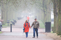 ©Licensed to London News Pictures 22/01/2020<br /> Greenwich, UK. A couple hold hands in Greenwich Park, London.  Freezing foggy weather conditions continue across London this afternoon. Photo credit: Grant Falvey/LNP